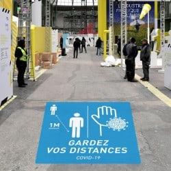 Marquage au sol avec message d'alerte « COVID-19 »
